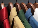 Colourful+shirts+on+wooden+hangers