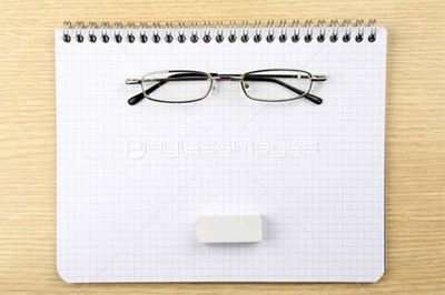 Glasses, reaser and notebook