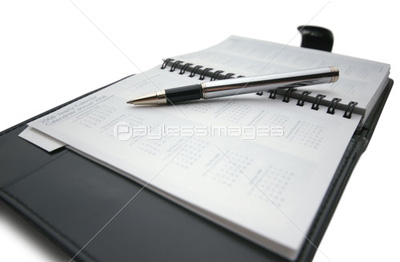 Pen on business day planner